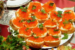 Red caviar. On bread on white plate Stock Photo