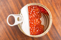Red caviar in bank with spoon on wood Royalty Free Stock Photography