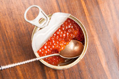 Red caviar in bank with spoon on wood Royalty Free Stock Photos