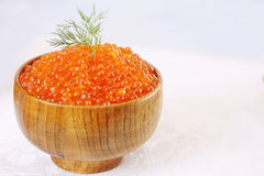 Red caviar in bowl, copy space Stock Photo