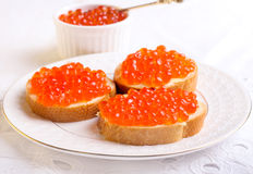 Red caviar on bread Stock Photography