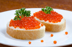 Red caviar with bread on a plate Royalty Free Stock Photography