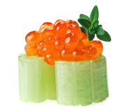 Red caviar canape with celery and thyme twig Stock Photo