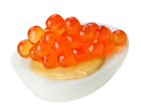 Red caviar canape with quail egg Royalty Free Stock Photo