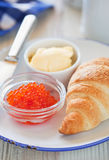 Red caviar and croissant Stock Image