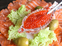 red caviar in a crystal bowl with salmon and green salad Royalty Free Stock Photo