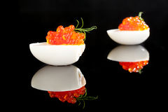 Red caviar in egg with dill. Royalty Free Stock Photography