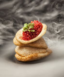 Red caviar. On fish chips Royalty Free Stock Photography