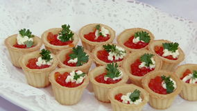 Red caviar and fish strawberries on table. stock footage