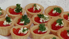 Red caviar and fish strawberries on table. stock video