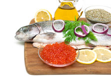 Red caviar and fresh trout on a cutting board Stock Photo