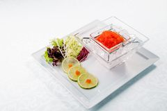 Red caviar in ice close up with lime. Sea food. wooden. Healthy eating Royalty Free Stock Photography