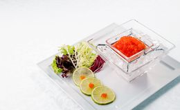 Red caviar in ice close up with lime. Sea food. wooden. Healthy eating Stock Images