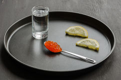 Red caviar, lemon and glass of vodka Royalty Free Stock Image