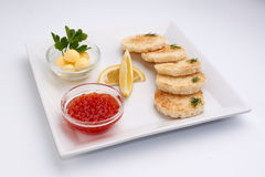 Red caviar. Lemon. Greens. Bread and butter Royalty Free Stock Image