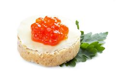 Red caviar open sandwich. Red caviar with bread and butter isolated over white background Stock Images