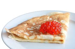 Red caviar on pancake. Red Caviar and pancake on a plate. Isolated Royalty Free Stock Photos