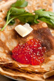 Red caviar on pancakes Royalty Free Stock Photos
