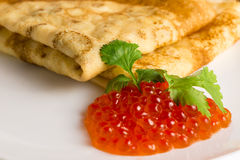 Red caviar and pancakes Royalty Free Stock Photos
