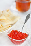 Red caviar, pancakes and cup of tea Stock Images