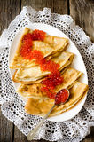 Red caviar with pancakes Royalty Free Stock Photography