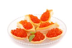 Red caviar. In pastries on glass transparent plate Stock Image