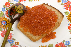 Red caviar on a piece of black bread Royalty Free Stock Photo