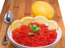 Red caviar on plate with lemon Royalty Free Stock Photography