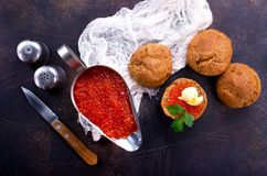 Red caviar. With bread and butter on a table royalty free stock photos