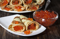Red caviar salmon fish with pancakes  . Royalty Free Stock Image
