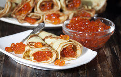 Red caviar salmon fish with pancakes  . Royalty Free Stock Photography