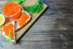 Red caviar on sandwiches. Expensive and healthy food.  Royalty Free Stock Images