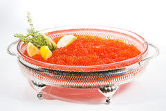 Red caviar in silver bowl isolated on white Royalty Free Stock Photo