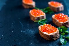 Red caviar on slate background. royalty free stock images