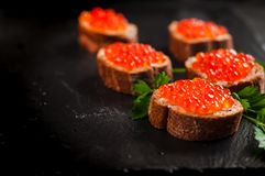 Red caviar on slate background. royalty free stock photos