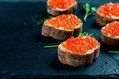 Red caviar on slate background. stock images