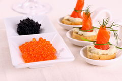 Red caviar and smoked salmon rolls Stock Photo