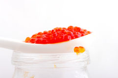 Red caviar on the spoon Stock Images
