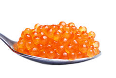 Red caviar in spoon. Isolated white background Stock Photo