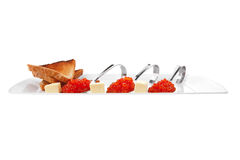 Red caviar on spoon Royalty Free Stock Images