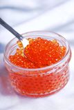 Red caviar in spoon Stock Photos