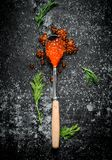 Red caviar in a spoon with dill. On black rustic background royalty free stock photography