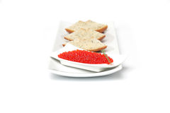 Red caviar  with spring onion and sliced bread Stock Photography