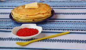 Red caviar and a stack of pancakes on the plate Royalty Free Stock Image