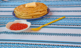 Red caviar and a stack of pancakes on the plate Royalty Free Stock Photo