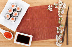 Red caviar, sushi set, sakura branch and chopsticks Stock Photography