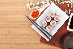 Red caviar, sushi set, sakura branch and chopsticks Royalty Free Stock Photo