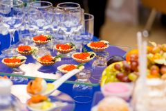 Red caviar on the table. Delicacies and Cutlery at the buffet. Catering stock photos