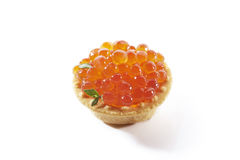 Red caviar in tartlet, isolated. On white background royalty free stock photos