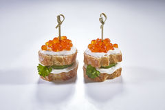 Red caviar in tartlet, isolated. On white background stock photo